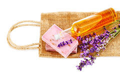 Bunch of lavender flowers, soap and oil isolated on white. Spa tr royalty free stock images