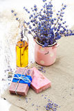 Bunch of lavender flowers,soap on old wooden background.Spa tre royalty free stock photo