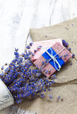 Bunch of lavender flowers,soap  on old wooden background.Spa tre Stock Photo
