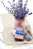Bunch of lavender flowers,soap  on old wooden background.Spa tre Royalty Free Stock Images