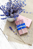 Bunch of lavender flowers,soap on old wooden background.Spa trea Royalty Free Stock Photography