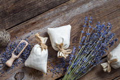Bunch of lavender flowers and three sachets filled with lavender Royalty Free Stock Photos
