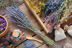 Bunch of lavender and medicinal herbs, mortar of dry flowers. Bunch of lavender and medicinal herbs, mortar of dry healthy flowers on wooden table. Herbal Stock Photo