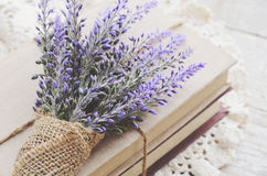 Bunch of lavender placed on book bundle Royalty Free Stock Photography