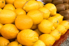 A bunch of lemons on the table in the market Royalty Free Stock Photo