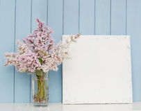 Bunch of lilac and blank canvas Stock Images