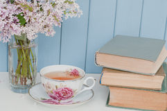 Bunch of lilac, books and teacup Royalty Free Stock Photos