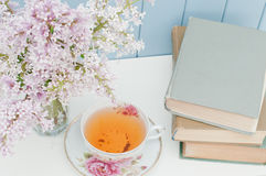Bunch of lilac, books and teacup Royalty Free Stock Images