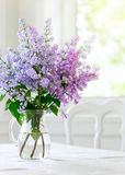 Bunch Lilac Flowers In Vase On Table Stock Photos