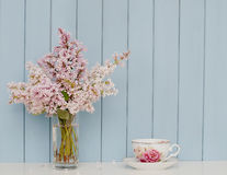 Bunch of lilac and teacup Royalty Free Stock Photo