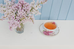 Bunch of lilac and teacup Royalty Free Stock Photos