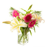 A bunch of lilies and gerberas in the transparent Stock Images