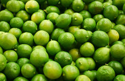 Bunch of limes. Bunch of fresh green limes stock photos