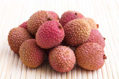 Bunch of litchis on bamboo matt Stock Photo