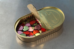 A bunch of little hearts in a tin Stock Photos