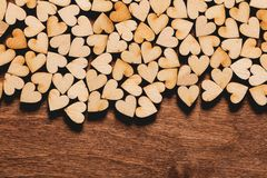 Little hearts on wooden background. Stock Photo