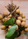 A bunch of Longan was placed on a wooden;Longan Stock Images