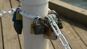 Bunch of love padlocks locked on seaside pier, tradition of romantic couples. Stock footage stock footage