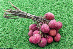 bunch of lychee on the grass background Royalty Free Stock Photos