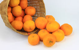 A bunch of mandarin orange in rattan basket Royalty Free Stock Images