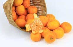 A bunch of mandarin orange in rattan basket Royalty Free Stock Photos