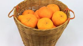 A bunch of mandarin orange in rattan basket Stock Image
