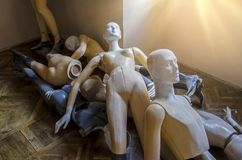 Bunch of mannequins lying on the parquet Royalty Free Stock Photos