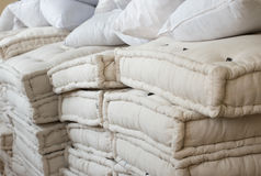 A bunch of mattresses and pillows for refugees. Donations for refugees in the form of mattresses and pillows Royalty Free Stock Image
