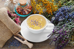 Bunch of medicinal herbs, healthy tea and bag of dry herbs. Stock Photography