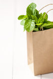 Bunch of the mint in a paper brown shopping bag Stock Photo