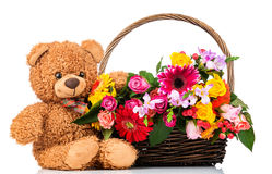 Bunch of mixed beautiful flowers and a teddy bear Royalty Free Stock Photography