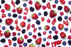 Bunch of mixed berries in harvest pile on white background. Colorful composition with fresh organic strawberry, blueberry, blackbe. Rry & redcurrant. Clean Stock Image