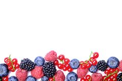 Bunch of mixed berries in harvest pile on white background. Colorful composition with fresh organic strawberry, blueberry, blackbe. Rry & redcurrant. Clean Stock Photos