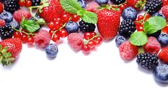 Bunch of mixed berries in harvest pile on white background. Colorful composition with fresh organic strawberry, blueberry, blackbe. Rry & redcurrant. Clean Royalty Free Stock Images