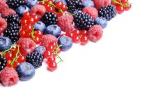 Bunch of mixed berries in harvest pile on white background. Colorful composition with fresh organic strawberry, blueberry, blackbe. Rry & redcurrant. Clean Royalty Free Stock Image