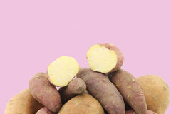 Bunch of mixed sweet potatoes and a cut one Stock Photography