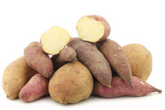 Bunch of mixed sweet potatoes Stock Images