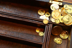 Bunch of modern gold coins in wooden casket Royalty Free Stock Photo