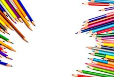 Color pencils on white background. Bunch of multi-color pencils on white background with copy space, top view Stock Photography