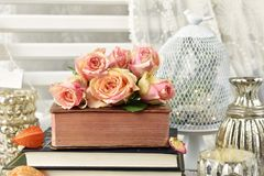 Bunch of multicolor roses lying on old book Royalty Free Stock Images