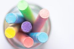 Bunch of Multicolored Chalks Crayons in Pencil Cup. Top View White Background. Education Arts Crafts Creativity. Concept. Elegant Minimalist Style. Website Royalty Free Stock Photo