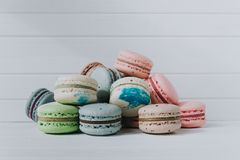 Bunch of multicolored macaroons or macaron on a white background, copy space. Bunch of multicolored macaroons or macaron on a white background, copy space Stock Photos