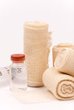 Bunch of new bandage rolls over white background Stock Images