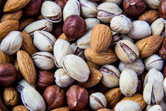 A bunch of nuts. As a background Royalty Free Stock Photography