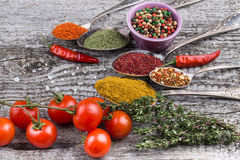 Bunch Of Cherry Tomatoes, Herbs, Small Bowl And Antic Metal Spoon Royalty Free Stock Image