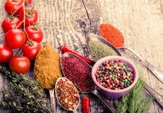 Bunch Of Cherry Tomatoes, Herbs, Small Bowl And Antic Metal Spoons With Different Kinds Of Spices, Sea Salt And Red Hot Chili Pep Stock Photos