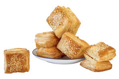 Bunch Of Small Square Sesame Puff Pastry Zu-Zu Isolated On White Background Stock Photo