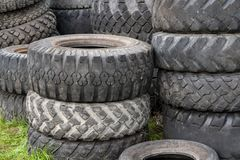 A bunch of old car tires outdoors. stock photography