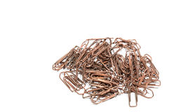 A bunch of old copper paperclip. Partially isolated Royalty Free Stock Photography