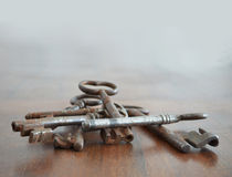 Bunch of old keys. Bunch of old rusted keys on wood surface Royalty Free Stock Image